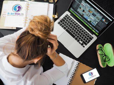 women desk stress supermom